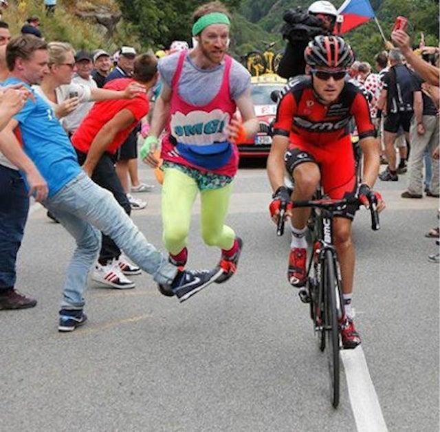 Spectator Picks Wrong Day To Run Alongside Tour de France Cyclist
