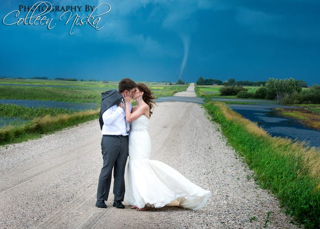 Couple gets their wedding photos with a tornado in the background