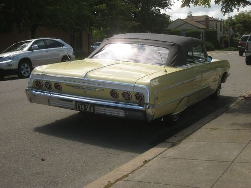1964 Chevrolet Impala Convertible Down On The Street
