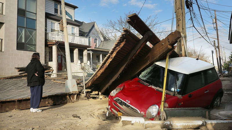 A Mini Goes Under The Boardwalk In Rockaway