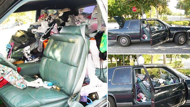 A Family of Five Lived in This Trash-Stuffed Car in a Wal-Mart Parking Lot