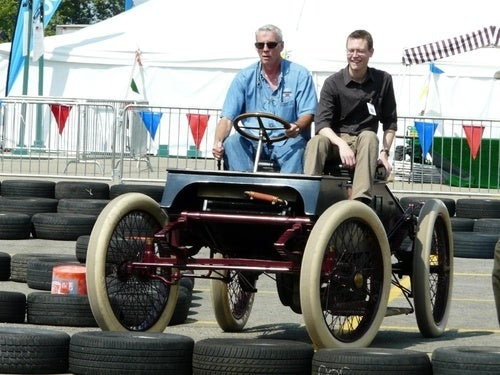 A 1901 Ford Racer On A Track Built For Power Wheels