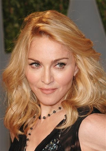 Dating Madonna Is A Religious Experience; Kimora Lee Simmons & Djimon Hounsou Married?