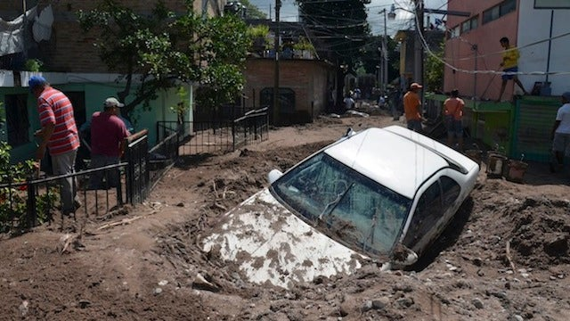 Dozens Killed and Thousands More Stranded as Twin Storms Hit Mexico