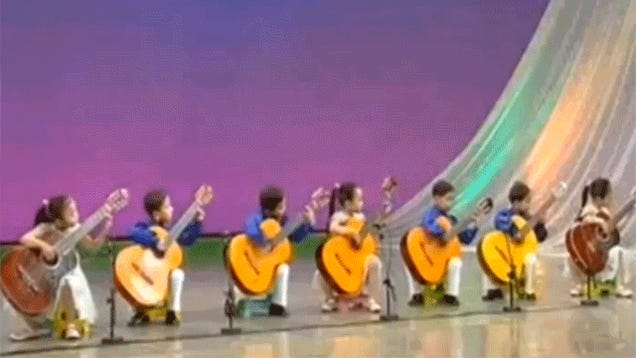 Can Anyone Find These North Korean Kids Smaller Guitars?