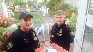 Hero Cops Finish Delivery After Pizza Hut Driver Gets in Car Accident