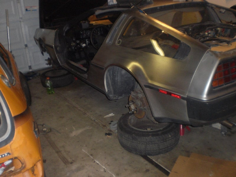 Evil Clint Gets A Few Loose Bolts, Buys DeLorean And Honda Z600 For Personal Hell Garage