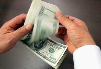 Shocker: Bankers Greedy Even When Handing Out Bonus Cash