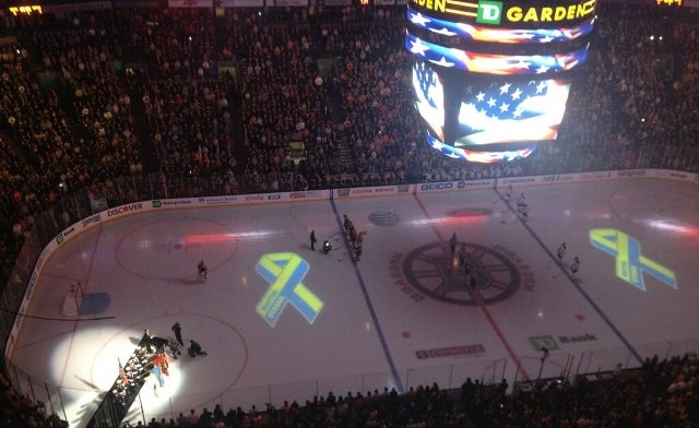 Thousands Join to Sing National Anthem Before Boston's First Major Sporting Event Since Marathon Bombing