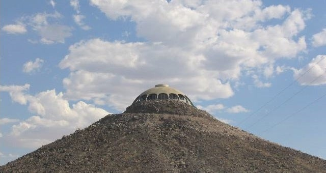 A House Shaped Like a Flying Saucer, Perched Atop a Volcano