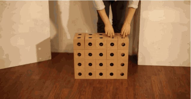 This mesmerizing sculpture is built of hinging wooden cubes