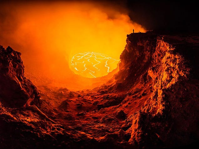 Stunning selfie of a lonely man facing a terrifying volcano pit