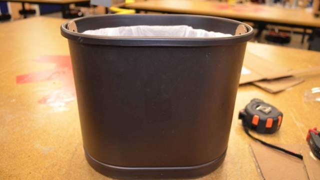 Keep Bags from Falling into Trash Cans with a Cardboard Insert