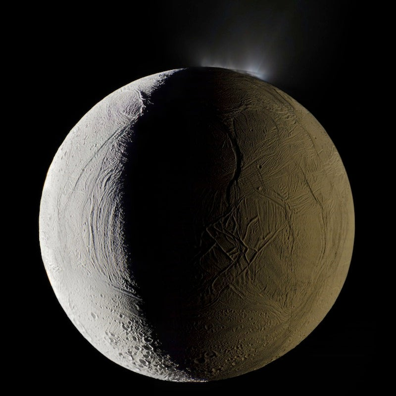 A geyser sprays water vapor from the surface of Saturn's moon Enceladus