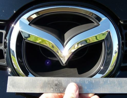 A Jalopnik Study: Does Car Logo Badge Size Correspond With Buyer Bulge Size?