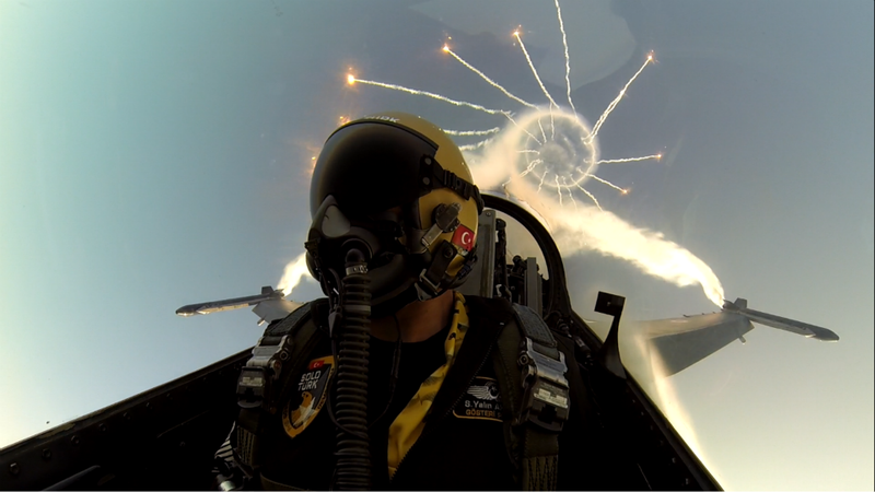 The whole world seems reflected on this F-16 pilot diving back to Earth