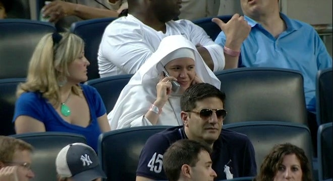 This Nun In Field-Level Seats At Yankee Stadium Just Had To Take That Call On Her Flip Phone