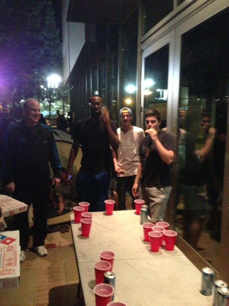 Here's A Photo Of UCLA Head Coach Ben Howland, In A Tracksuit, Playing Beer Pong With Students Last Night