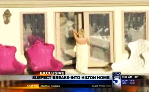 Paris Hilton Cavorts Half-Naked After Surviving Home Invasion