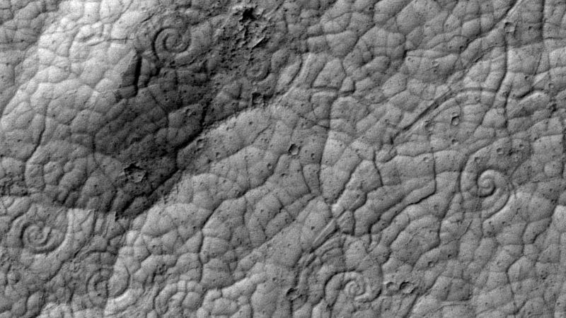 Why are there spirals on the surface of Mars?