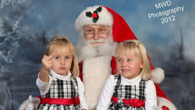 Naughty Little Girl Shows Off Her Christmas Spirit in Best Santa Photo Ever