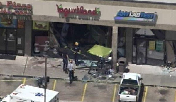 Out-of-control Acura crashes into two stores