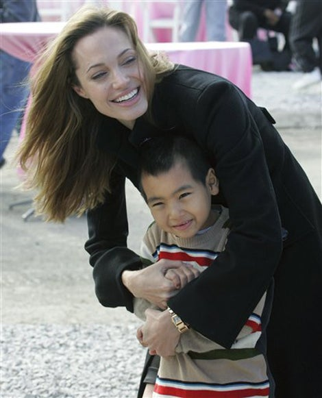 Angelina & Maddox Watch Brad From The Sidelines