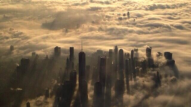 Two beautiful aerial photos of New York shrouded in fog this morning