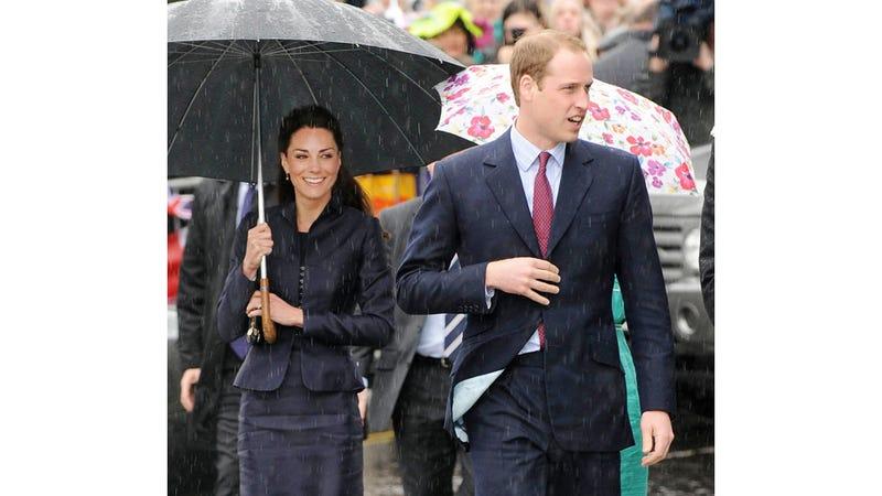 Prince William & Kate Middleton Smile Through A Little April Shower