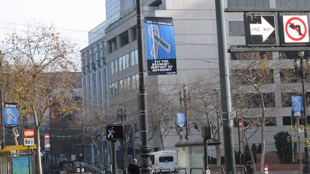 Silver-Ribboned Banners Fly For Reproductive Rights