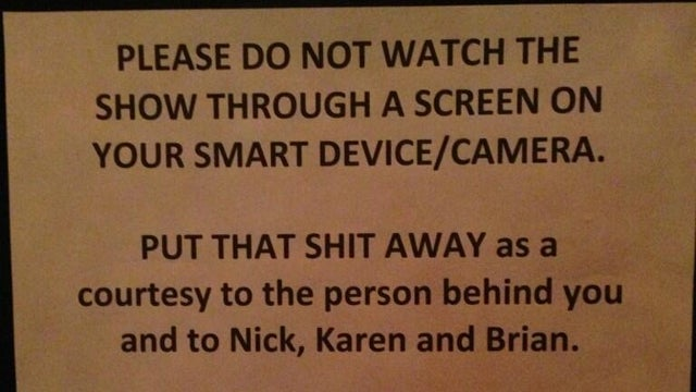 Yeah Yeah Yeahs Post Sadly Necessary Sign Asking Fans Not to Watch Their Show Through a Smartphone Screen