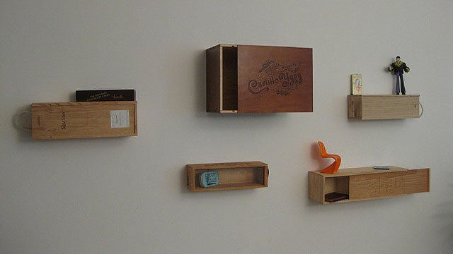 use empty wine crates for easy wall mounted storage