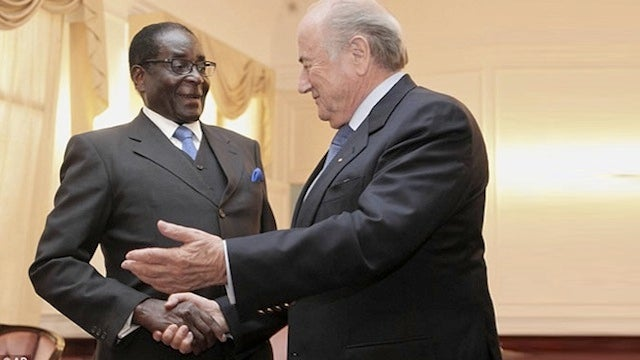 Here's A Photo Of A Prominent Public Figure Glad-Handing A Brutal Despot