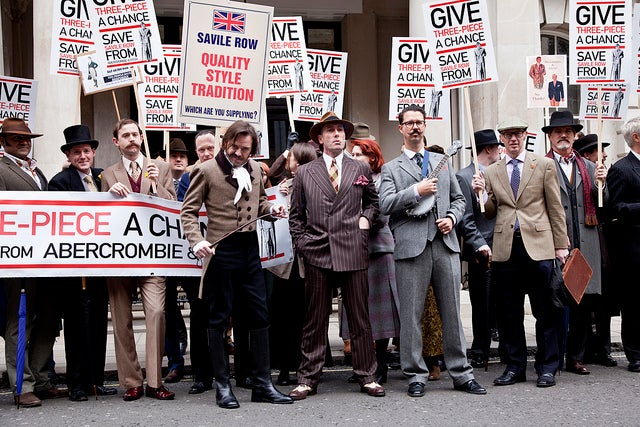 Smartly Dressed Demonstrators Peacefully Protest Abercrombie & Fitch Takeover of Savile Row