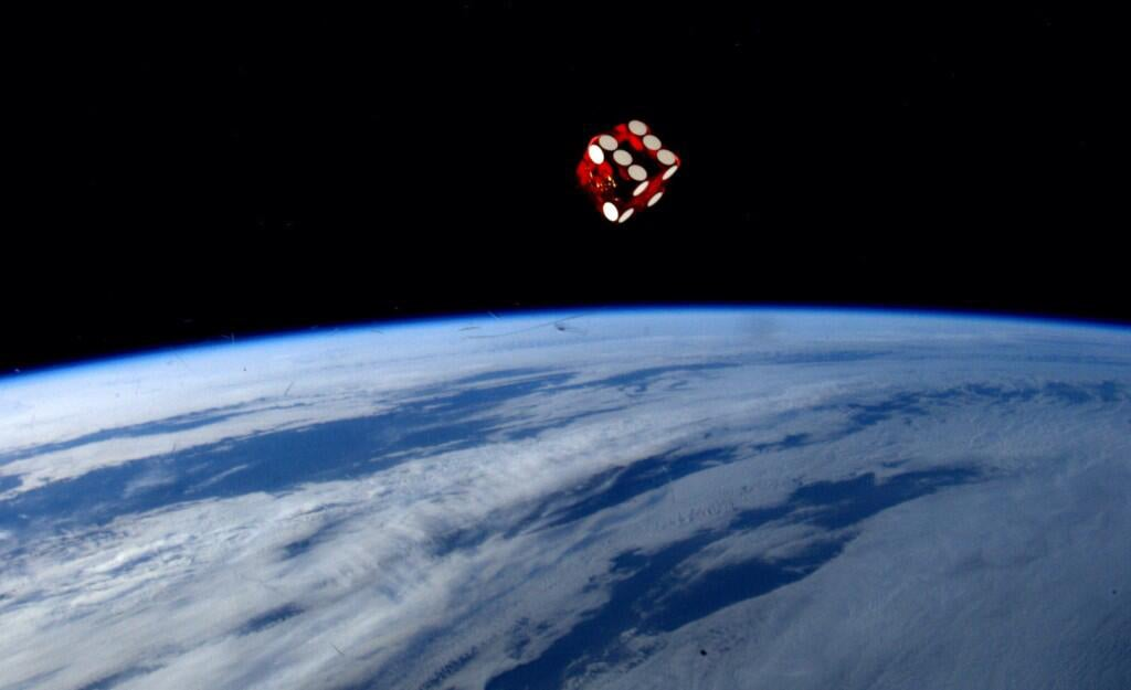 This image of a dice rolling in space over the Earth is not a photoshop