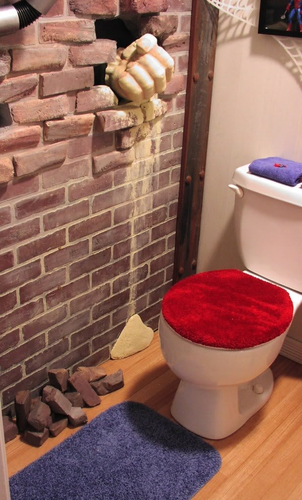 In this Spider-Man themed bathroom, The Lizard is watching you poop