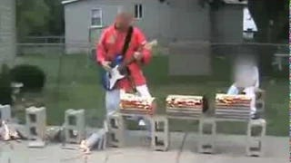 Playing Guitar While Doing Fire Karate Is A Great Hobby