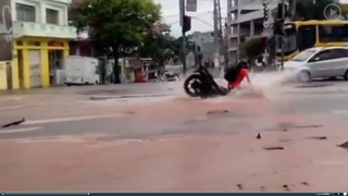 Two Wheels Bad - Pothole in Brazil swallows motorcyclist