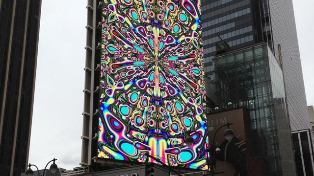 A broken billboard looks psychedelically drugged out