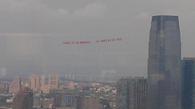 Plane Above Wall Street: 'Thanks for the Downgrade. You Should All Be Fired'