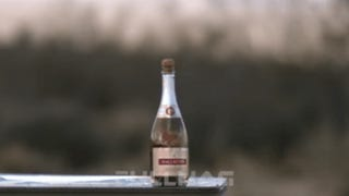 Uncorking A Champagne Bottle With A Huge Sniper Rifle