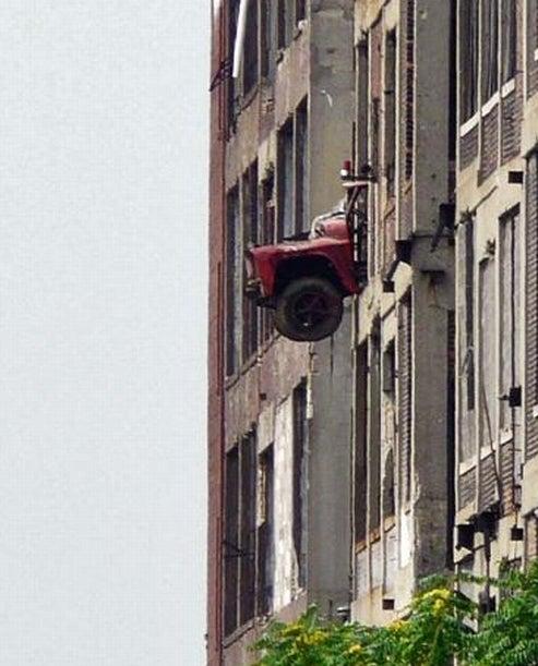Dang Detroit Kids Push Abandoned Dump Truck Out Packard Plant Window
