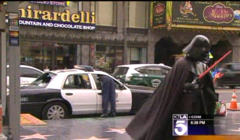 Man Smashes Windows Of LAPD Car In Front Of Darth Vader