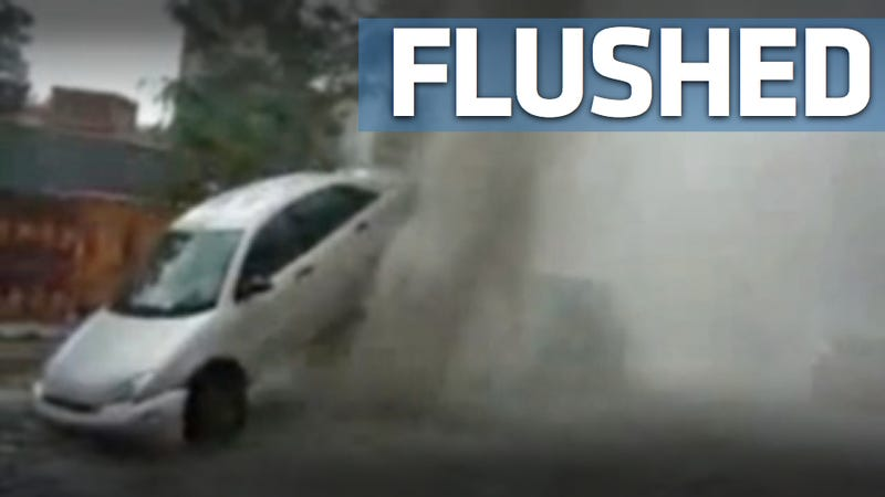 Watch the crazy force of a sewer geyser lift a car in the air