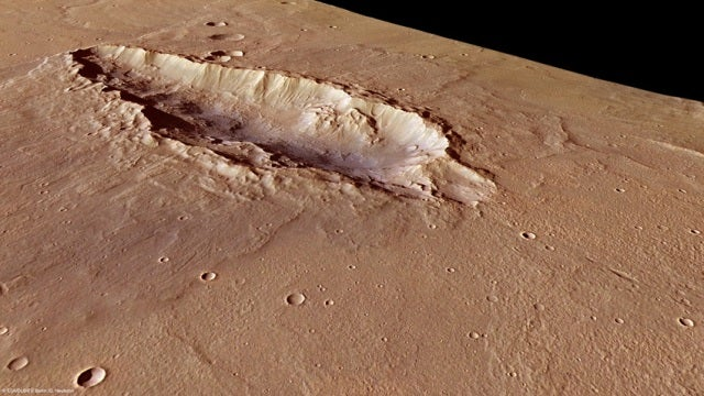 Martian crater gets hit by meteorites again...and again...and again