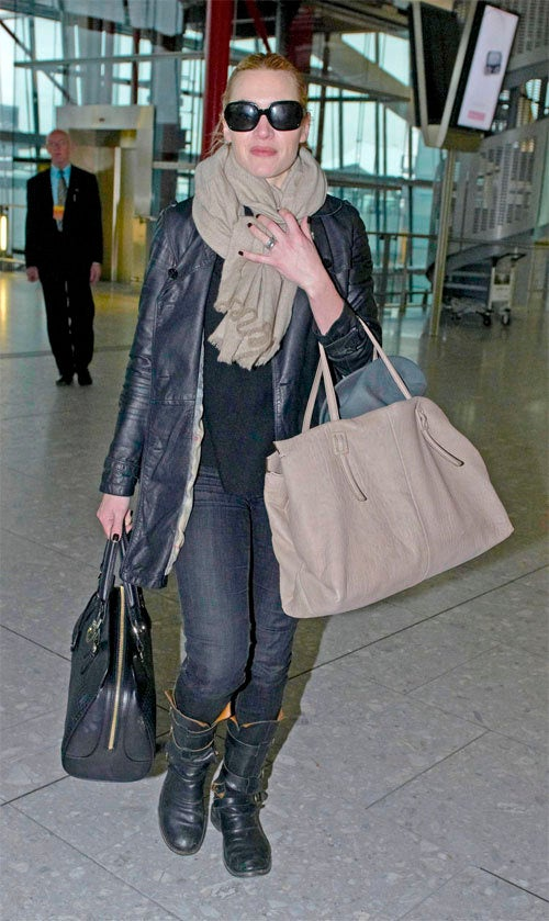 Three Bags, Two Boots, One Awesome Lady