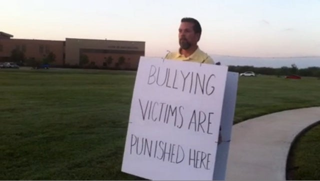 Teen Suspended for Standing Up to Longtime Bully Back In Class After Dad Spends Days Protesting Outside School