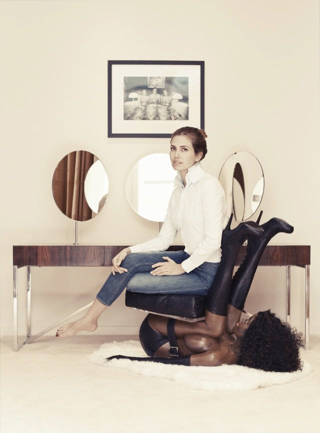 Today In WTF: Russian Socialite Poses On Chair Made Of A Black Woman