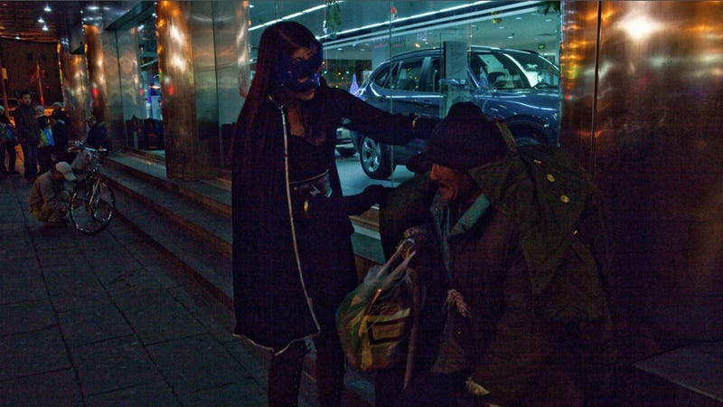 Real-Life Superhero Helps the Homeless with Food, Money, and Cleavage