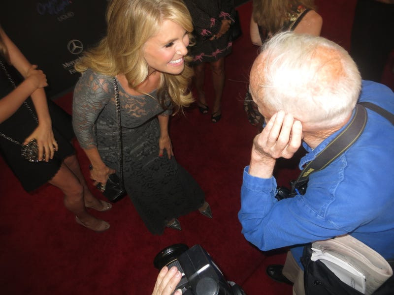 Christie Brinkley Whispering Sweet Nothings Into Bill Cunningham's Ear